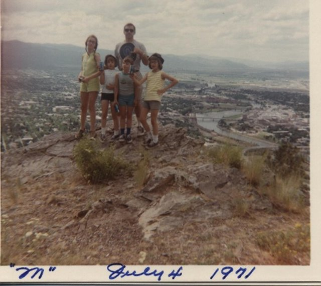 Dad and daughters on mountain top