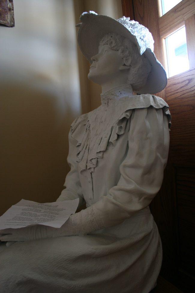 statue woman katy depot