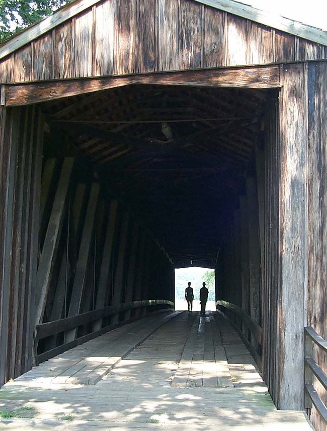 People walking across Burfordville Bridge