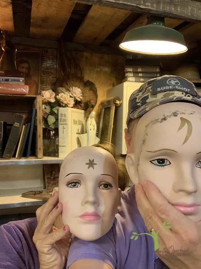 two masks at junk shop