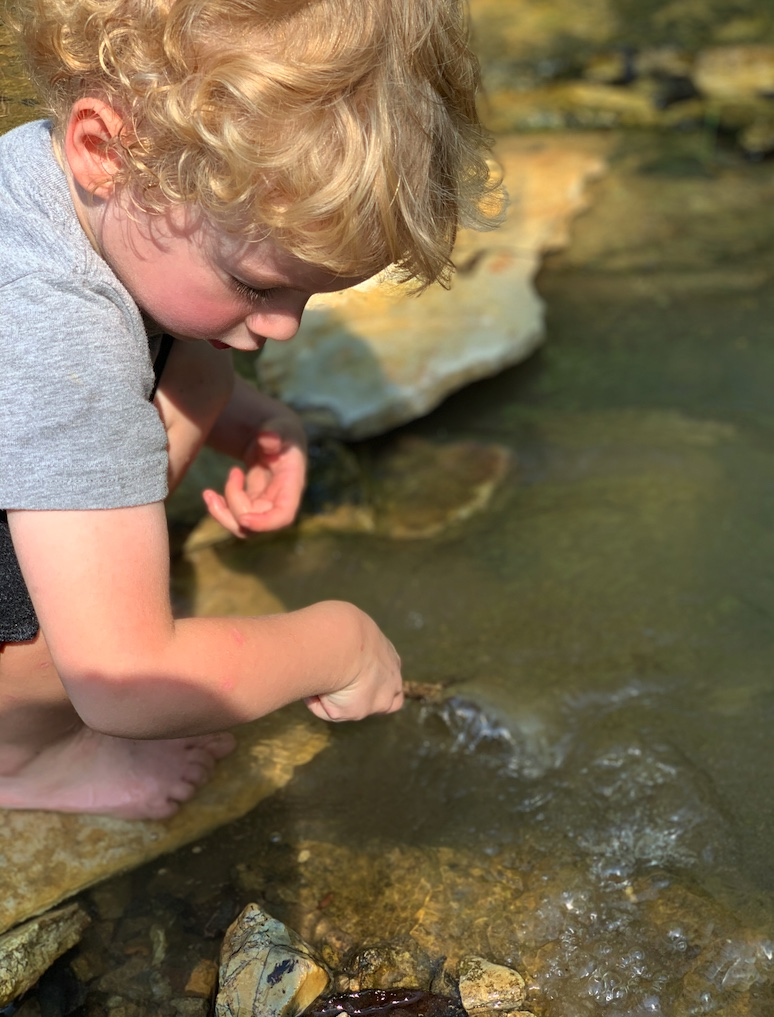 Little boy at creek