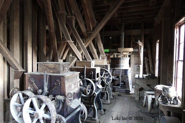 interior topaz mill with roller mills and grist mill on end