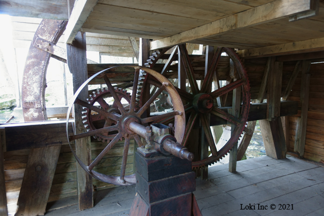Mill interior with gears and pulley